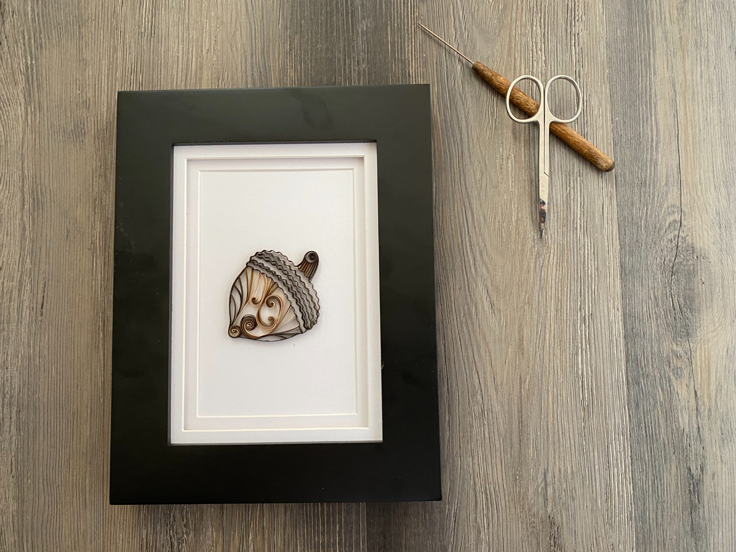 framed brown quilling paper acorn